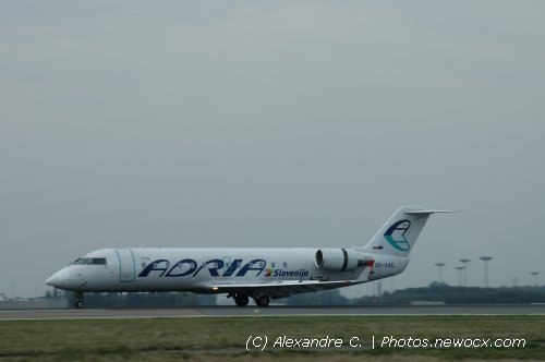 Photo avion S5-AAE : Canadair Regional Jet de la compagie Adria Airways (Paris Charles de Gaulle (LFPG))